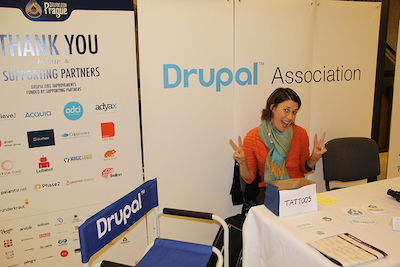 Megan Sanicki sits at Drupal Association table in DrupalCon Portland